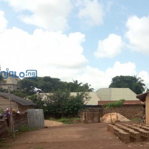 3 plots of land situate and lying at Afikpo street Abakaliki, behind AnanWorld in Ebonyi State, with a perimeter fence and a small structure inside