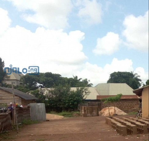 3-plots-of-land-situate-and-lying-at-afikpo-street-abakaliki-behind-ananworld-in-ebonyi-state-with-a-perimeter-fence-and-a-small-structure-inside-big-0